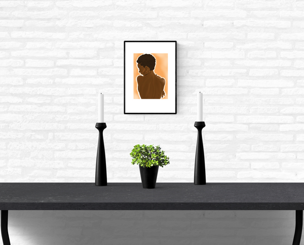 Art Illustration of a black woman's nude back, framed and mounted on an interior white brick wall