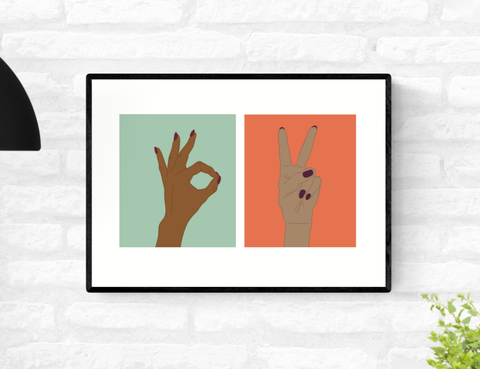 Framed wall art print of two hands. One displaying the A-Okay gesture and the second displaying the peace hand sign gesture