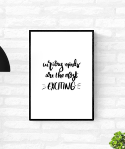 "Wall quote print that is framed and mounted on a wall with the words, ""curious minds are the most exciting"""