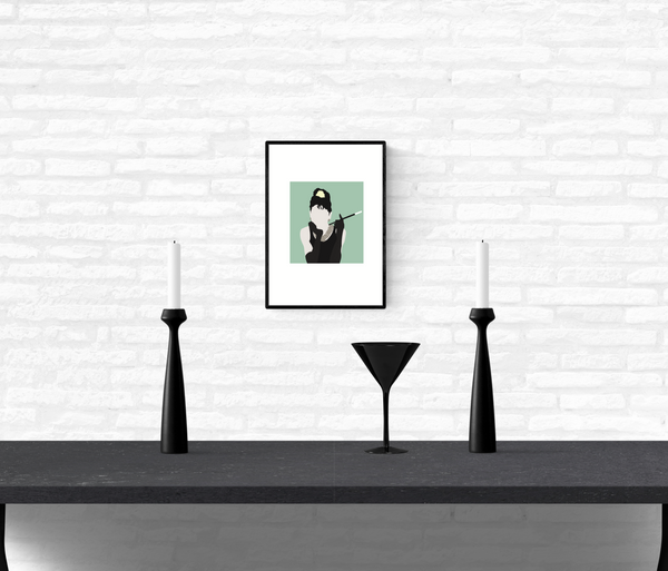 Wall art print hanging on a home's interior white brick wall of Holly Golightly from Breakfast At Tiffany's holding a cigarette