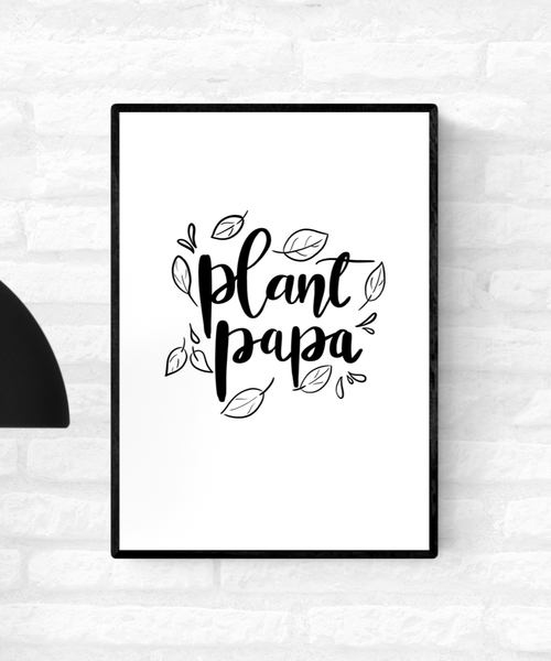 "Framed black and white art illustration with the words, ""Plant Papa"", surrounded by leaves"