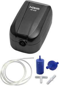 a single outlet aquarium air pump with a glossy black finish with a blue air stone, some transparent tubing plus valve and connectors