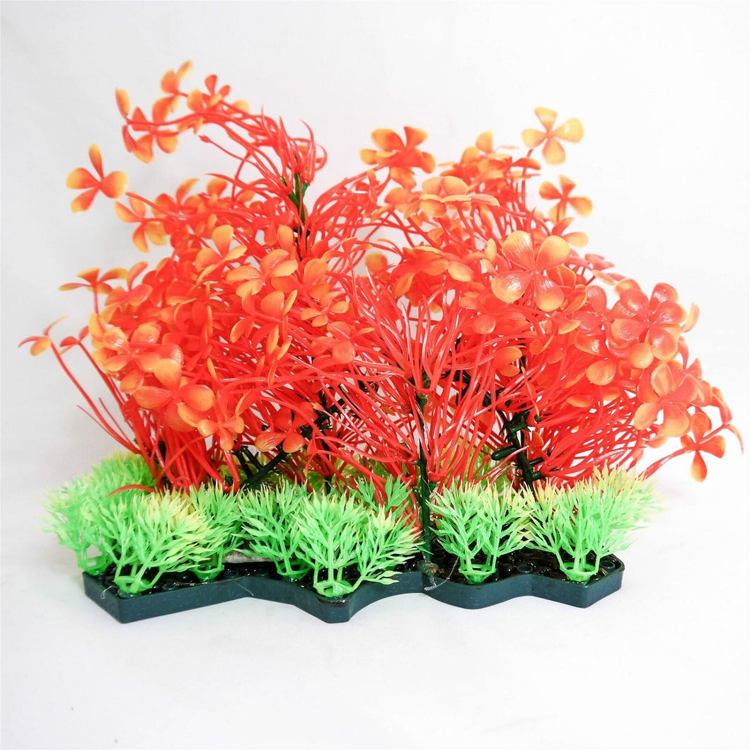 a cluster of orange foliage covering plants of various types on a single base