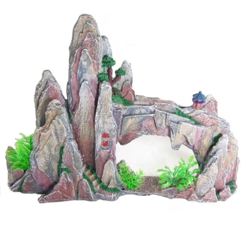 a large aquarium ornament mountain with a bridge spanning across