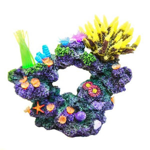 a realistic looking coral rock aquarium ornament covered with polyps