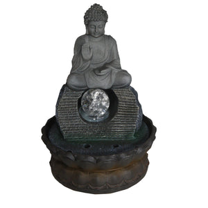 indoor water feature with a buddha sitting on top