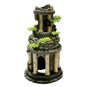 Tall roman tower structure surrounded by white pillars and outcrops of small green plants