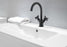 Ava Series Single Hole Cross Handle Bathroom Faucet in Matte Black finish