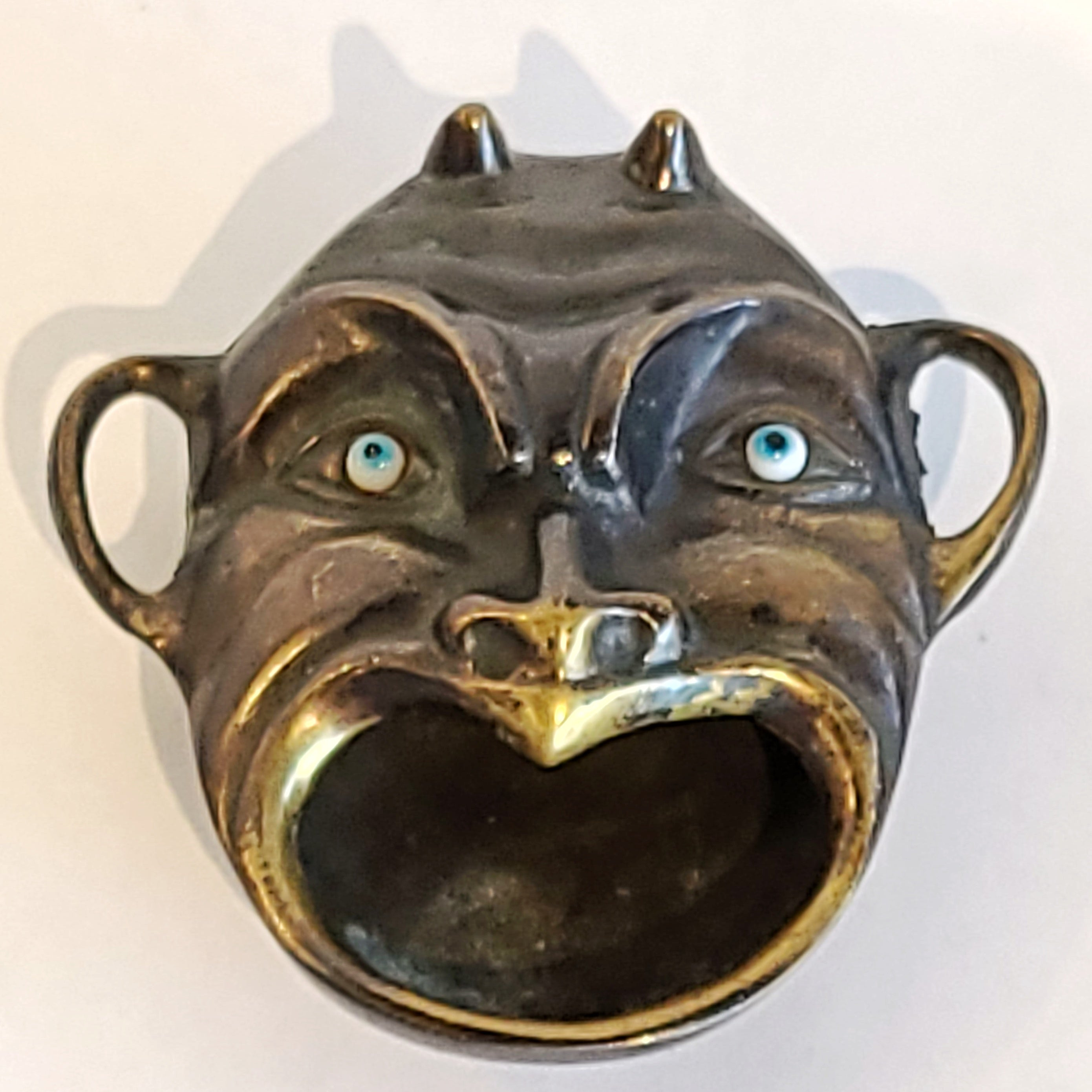 ANTIQUE BRASS DEVIL'S HEAD ASHTRAY WITH GLASS EYES