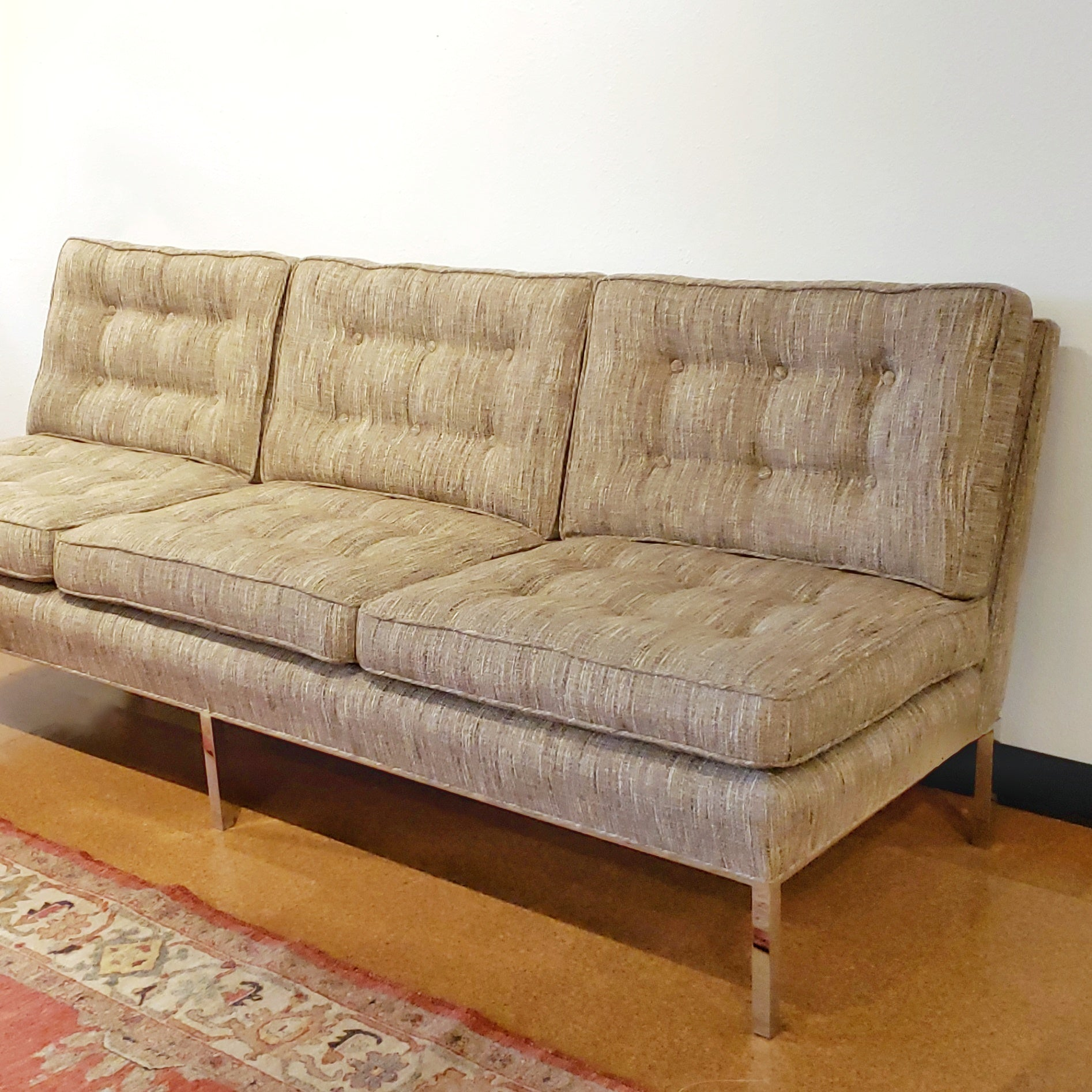 ARMLESS SOFA WITH CHROMED STEEL PLATFORM BASE