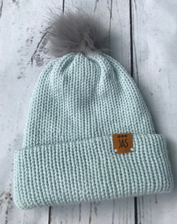 Light teal double thick beanie with grey faux fur pom pom