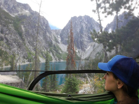 A look out of the Stratos Shield, enjoying the beautiful view of Colchuck Lake in Washington, the best spot to hammock camp!