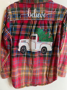 RED CHECKERED FLANNEL SHIRT WITH BELIEVE ON BACK