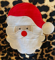 Leopard Top with Santa Face and jeans