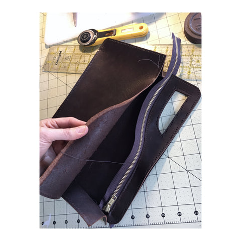 Handsewn leather clutch handbag zipper