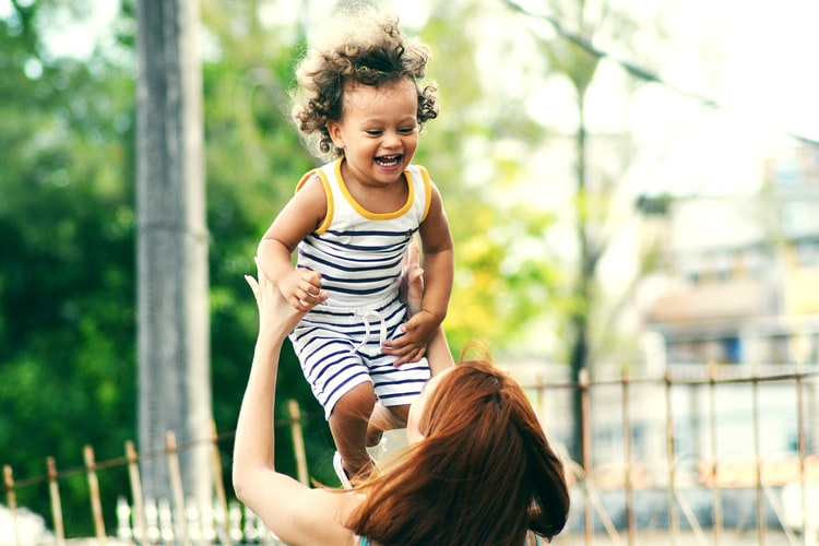 l carnitine gives energy to mom playing with child