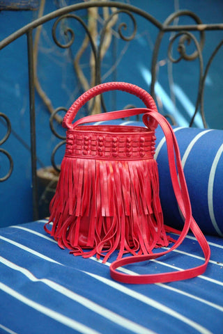 Bright red crossbody bucket bag with fringe detailing makes a great Valentine's Day accessory