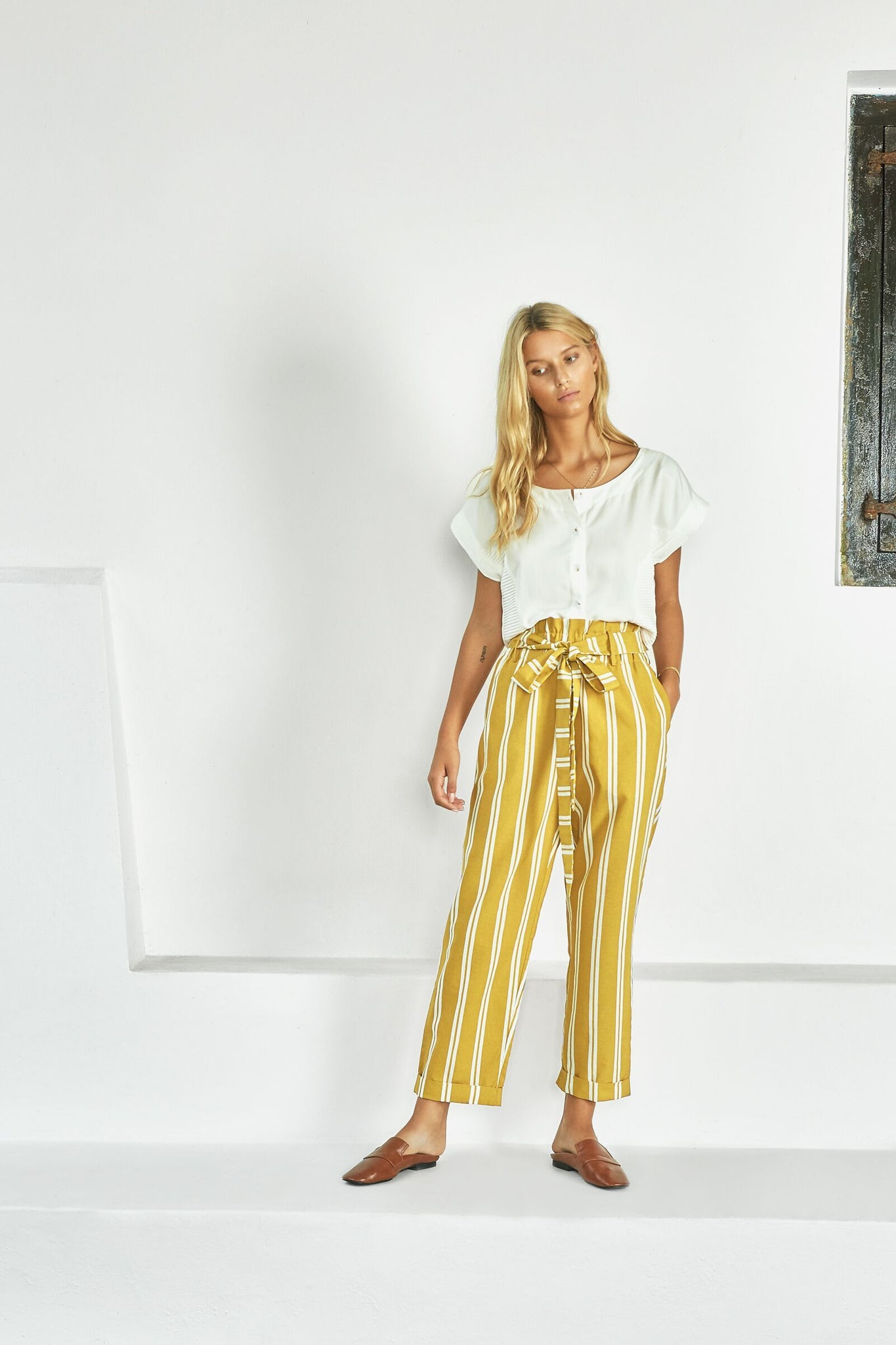 Shop the mustard high-waisted paperbag pants with stripes from Sancia