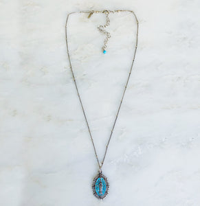 vintage-blue-intricate-elongated-virgin-mary