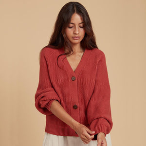 cardigan sleeves pushed up with buttons
