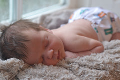 Picture of sleeping baby in cloth nappy
