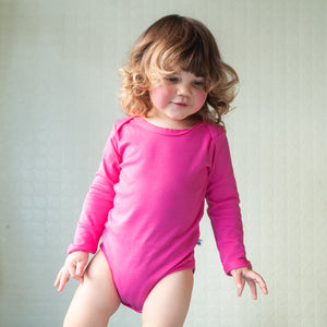 plain coloured bright pink long sleeve baby vest bodysuit organic cotton unisex gender neutral
