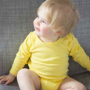 plain coloured bright yellow long sleeve baby vest bodysuit organic cotton unisex gender neutral