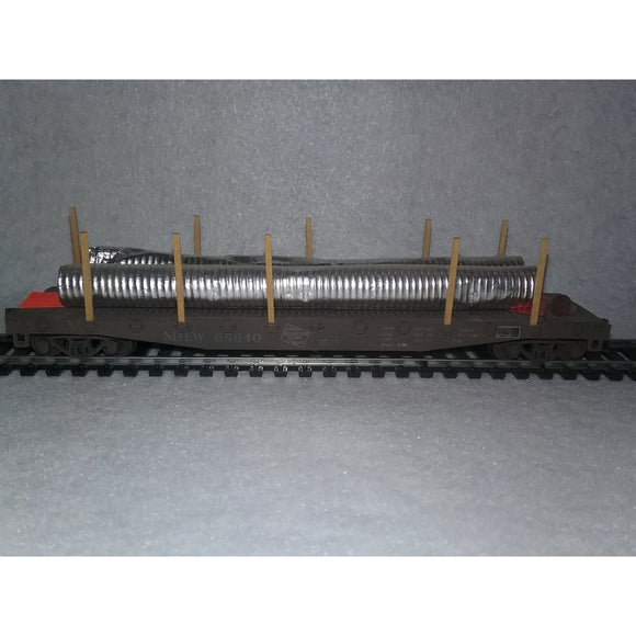 HO Scale Milwaukee Road Flat Car With Pipes