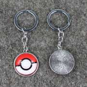 pokemon pokeball glass keychains with one facing downwards