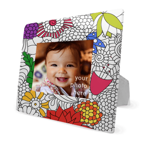 partially colored coloring book picture frame in monochromatic flowers design