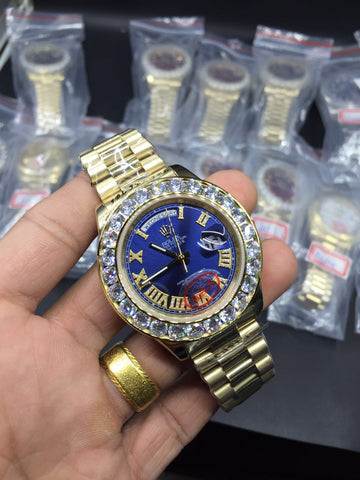 Gold bands iced out bezel blue dial rolex day date replica watch - top quality swiss movement knockoff replica designer watches from rolex, migos iced out philippe patek , AP, hublot and bust down iced out diamond jewelry