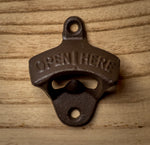 Cast-iron wall-mount bottle opener.