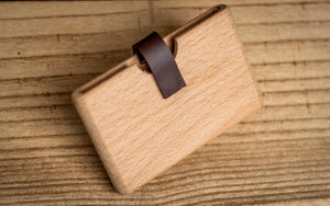 Bamboo wallet and business card holder with magnetic leather strap.