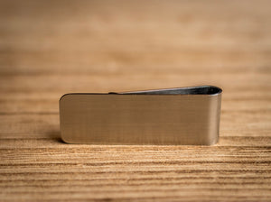 Brushed stainless steel money clip. (Front)