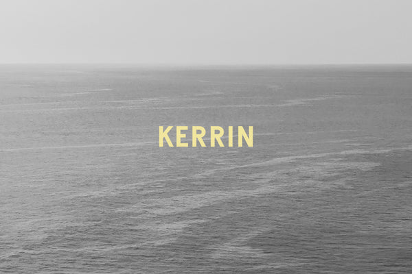 Kerrin logotype in yellow atop black and white seascape