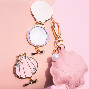 mermaid shell compact mirror pin with dinglehopper charm