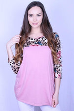 "3/4"" sleeve top with pink bodice and leopard floral sleeves"