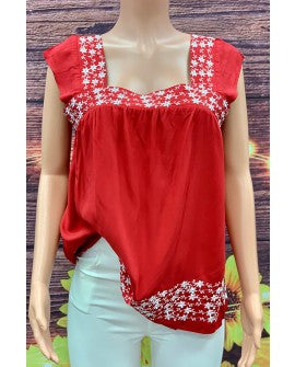 Red sleeveless blouse w/white floral embroidery details