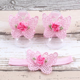 Pink butterfly barefoot sandal and headband set with a small flower on it