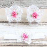 White butterfly shaped baby sandal and headband set with a dark pink flower