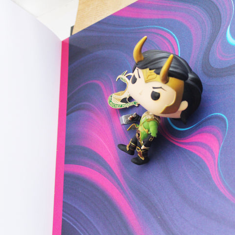 Loki funko pop on colorful background paper for instagram