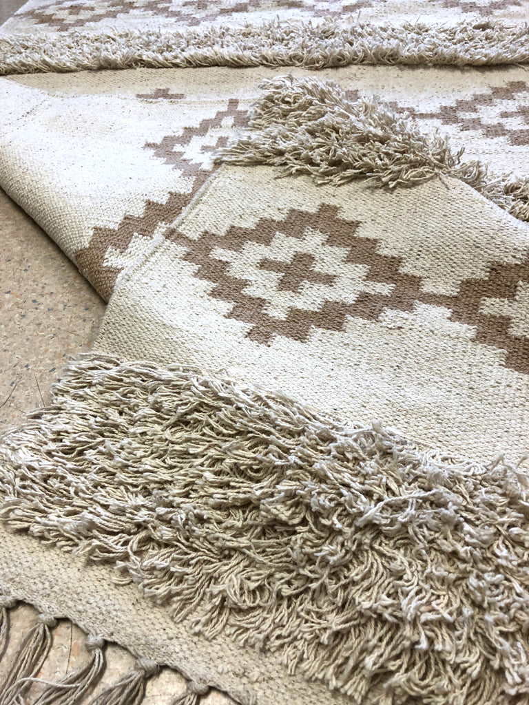 Hand loomed cotton rug
