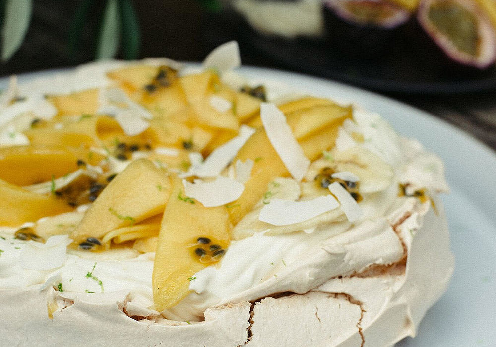 PAVLOVA WITH CRÈME FRAÎCHE, COCONUT AND TROPICAL FRUITS