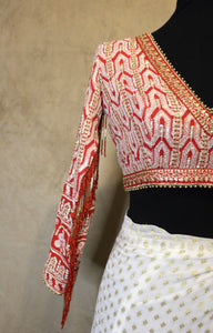 Red lucknowi blouse with tassles