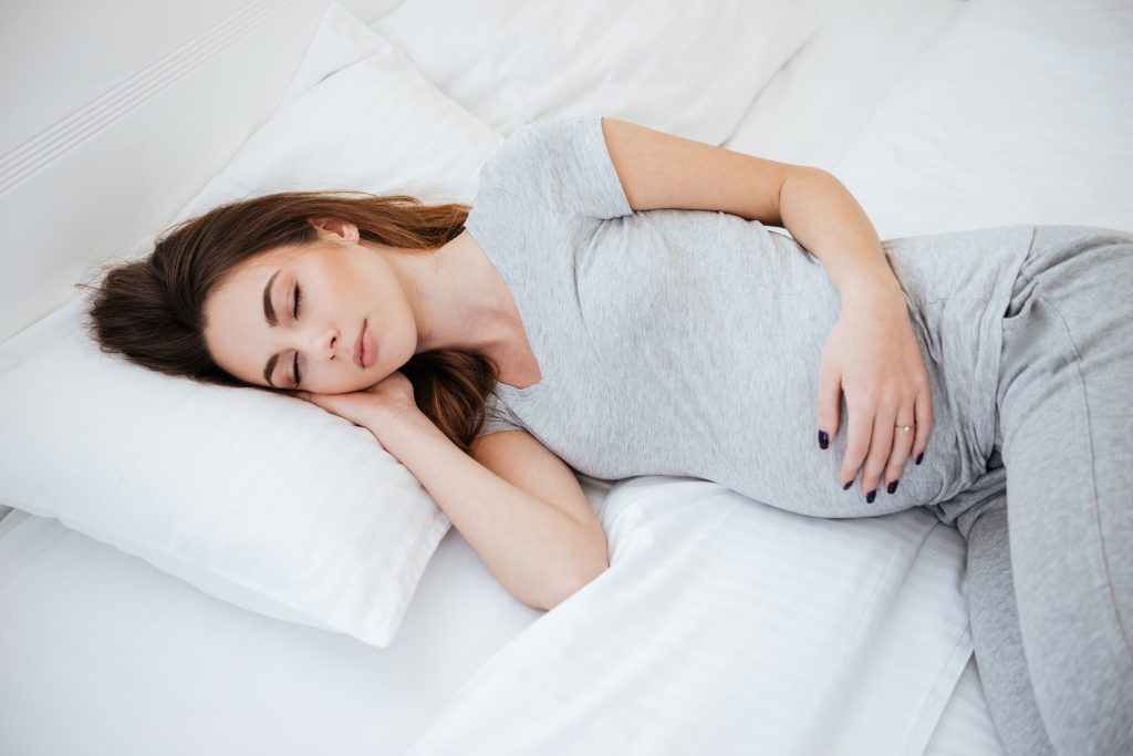 How a White Noise Machine Can Help You Sleep Through Your Pregnancy - Yogasleep | Love Real Sleep