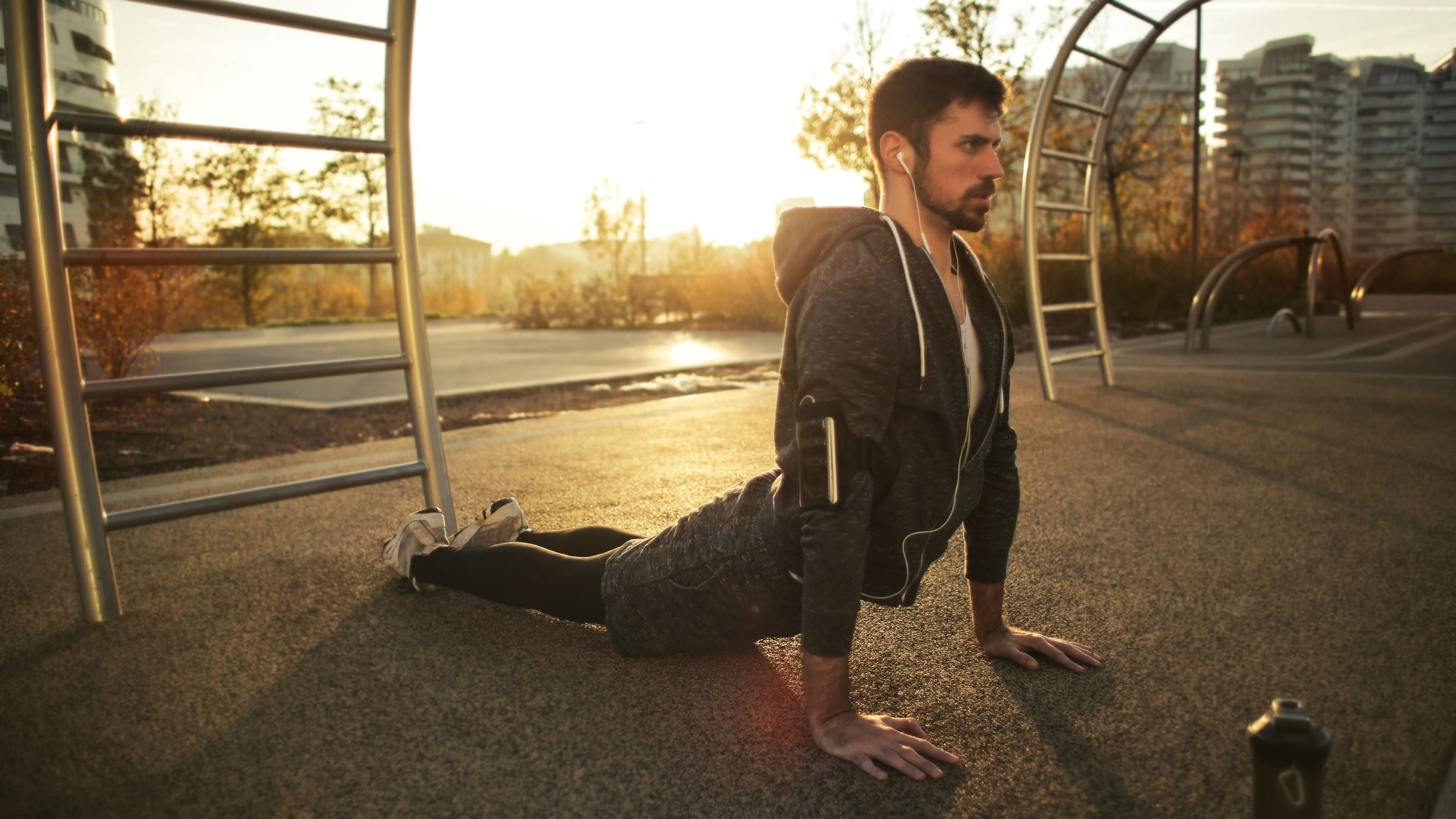 man stretching outside in the evening