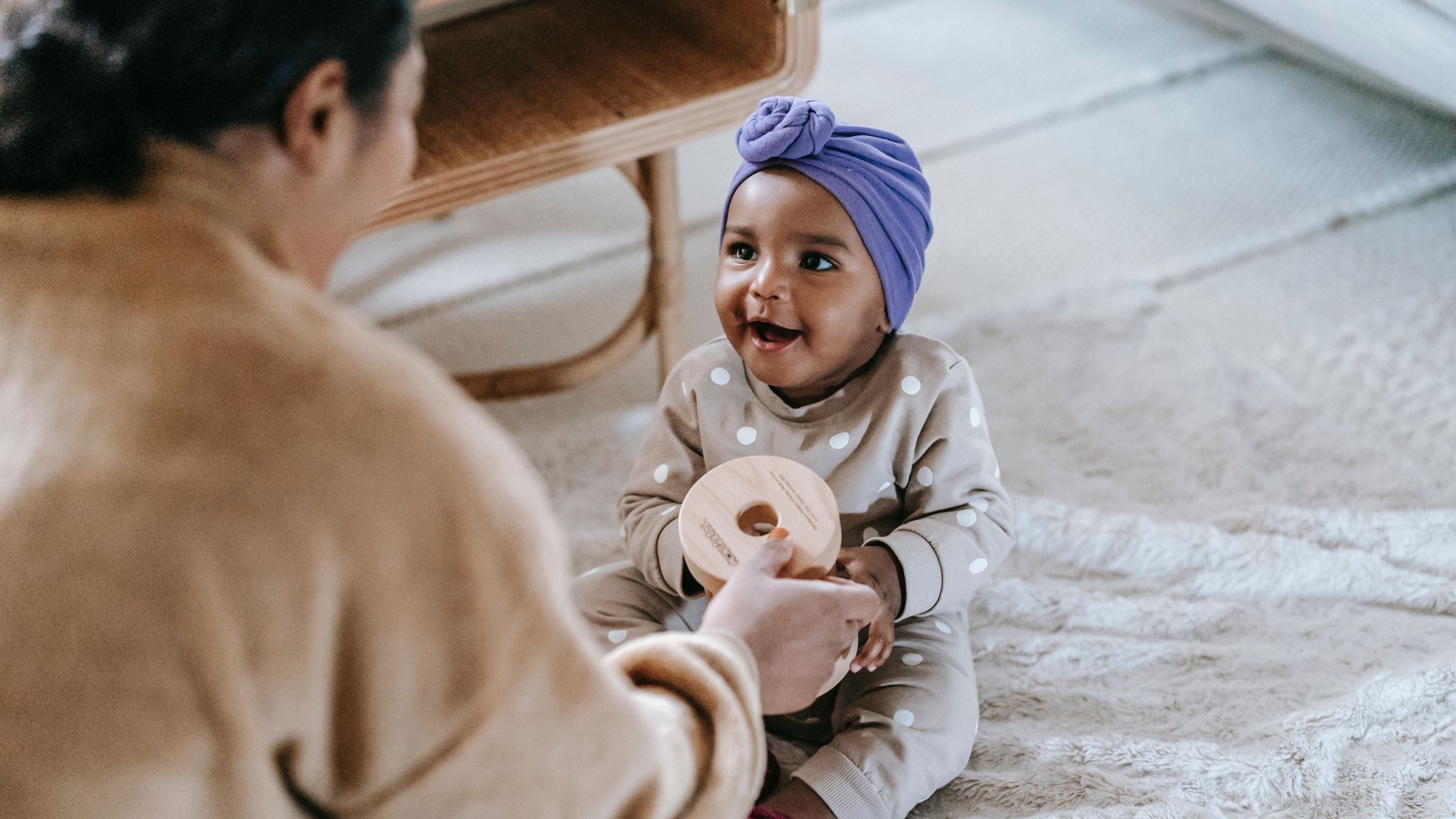 baby playing with woman half out of frame