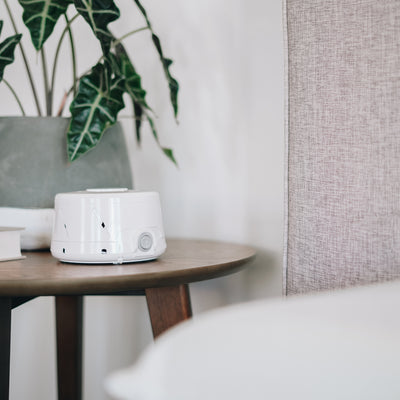 Dohm Classic Natural Sleep Sound Machine from Yogasleep - lifestyle on nightstand