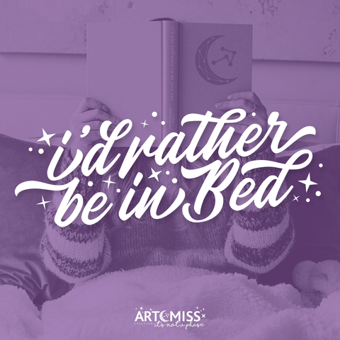 "White quote on purple background image of girl reading in bed. ""I'd rather be in bed"""
