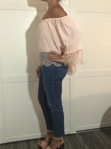 side view of lady wearing pale pink Lace detail Bardot top - LB Boutique